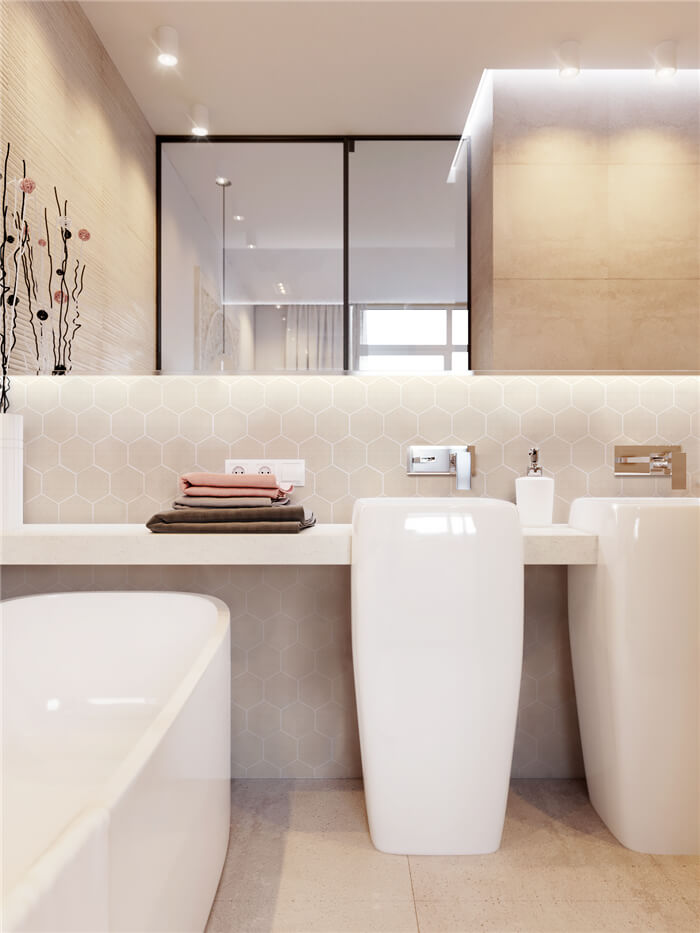 bathroom design with ligth tone flooring and beige hexagon tile wall.jpg