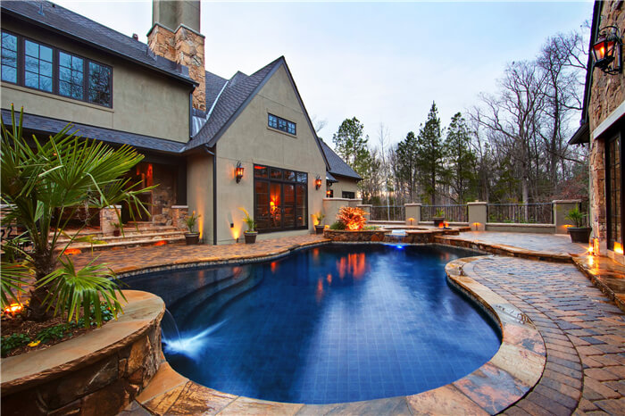 cobalt blue mosaic pool tiles match well with the house design.jpg
