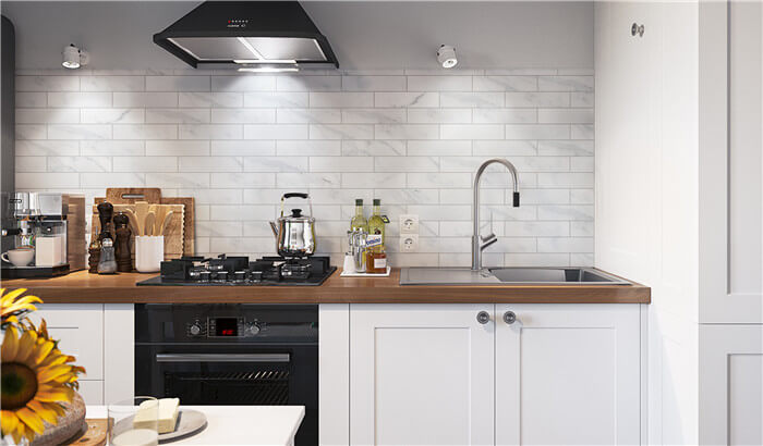 kitchen backsplash using brickbond porcelain tile that looks like marble.jpg