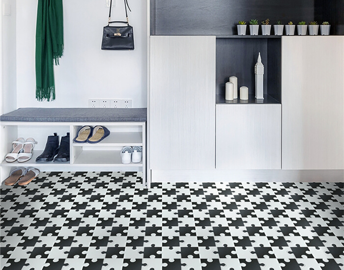entryway using black and white interlocking mosaic tile for floor paving.jpg