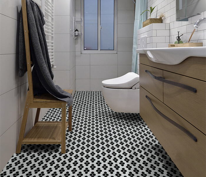 bathroom using black white hexagon mosaic flooring.jpg