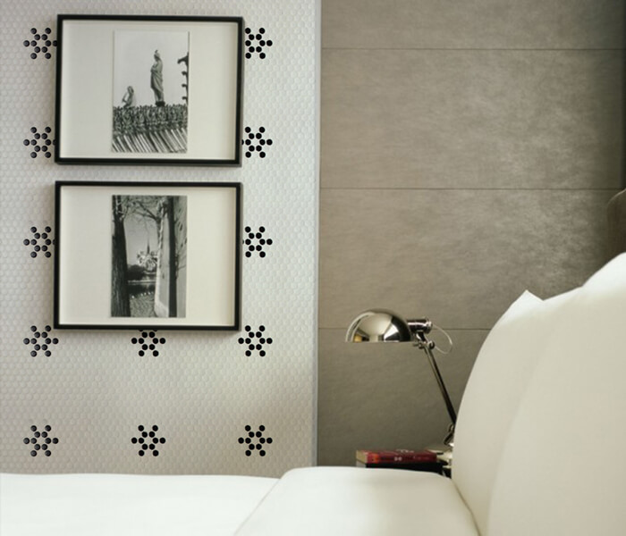 bedroom using black white flower pattern penny tile on wall.jpg
