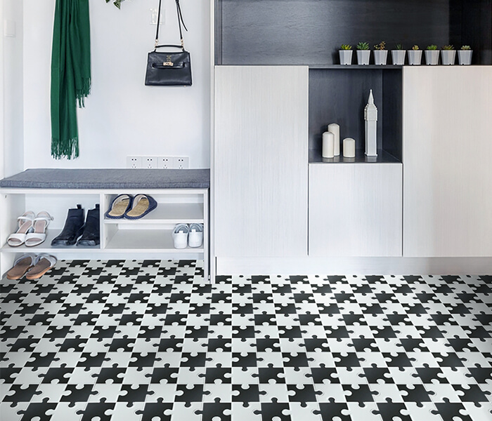 cloakroom using black white puzzle design floor tile mosaic.jpg