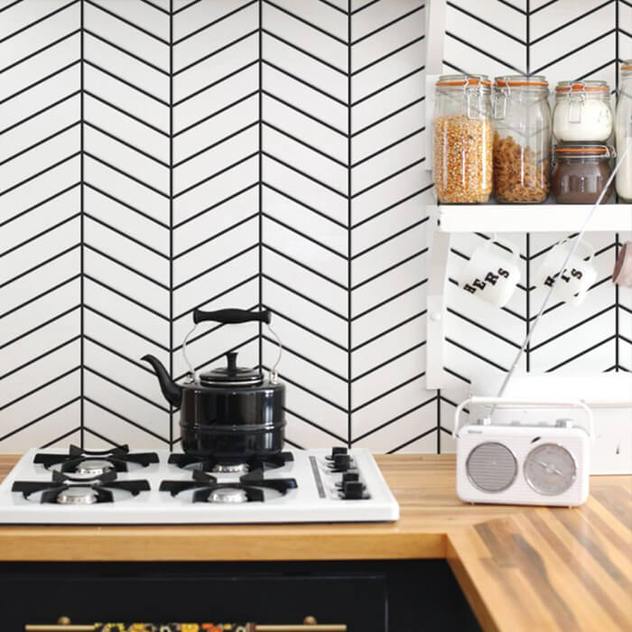 kitchen design using herringbone white tiles.jpg