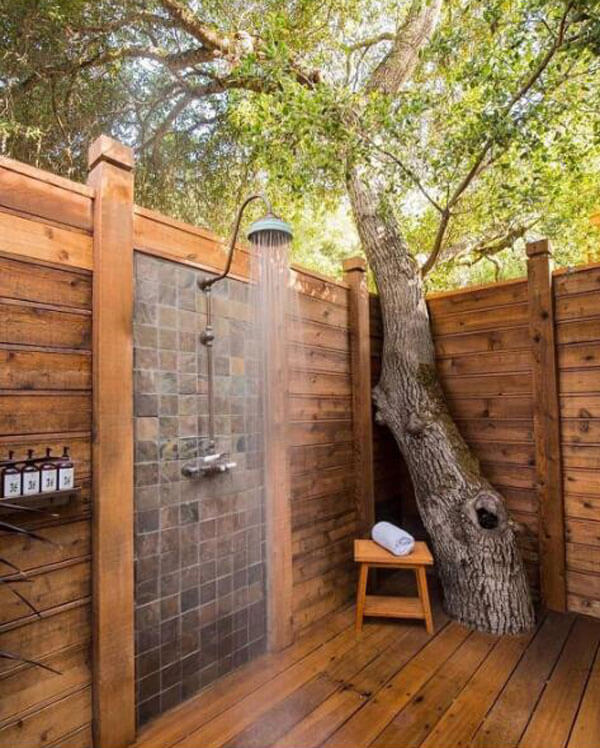 rustic outdoor shower with plain porcelain tiles