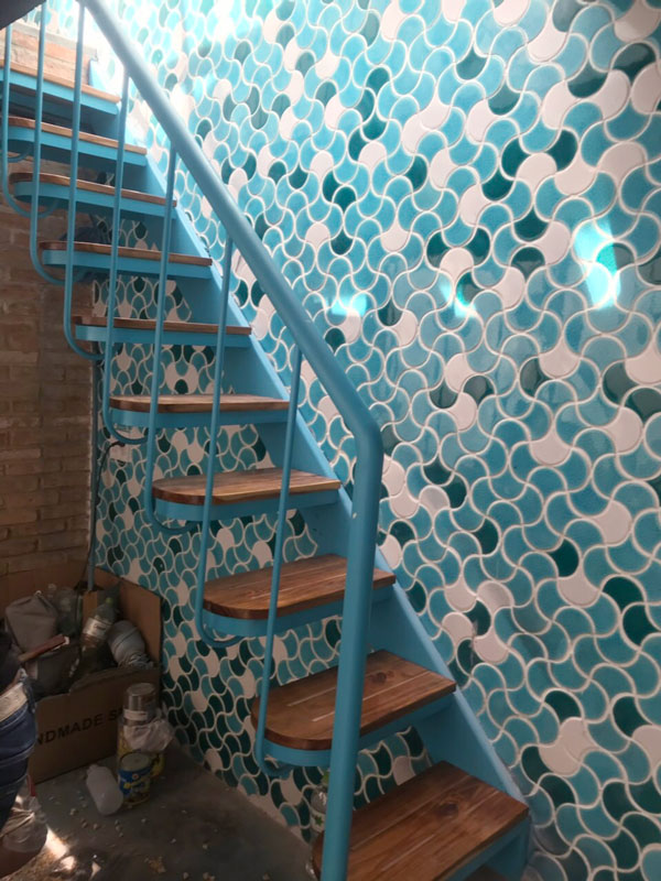 the stair background walls are mixed mosaic tiles