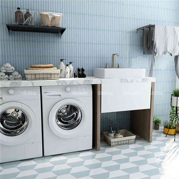 laundry room with blue porclein subway tiles